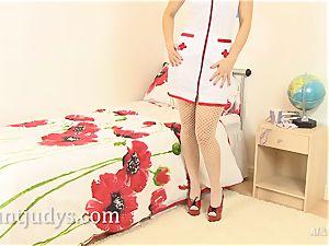 Mature nurse Penny Brooks paws her mature snatch