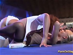 kinky sapphic hook-up on public stage