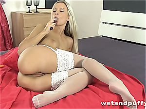 babe in milky stockings fumbles herself with fake penis