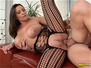 ample boobied voluptuous Jane humps in fishnet