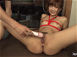 strapping her up and making her squirt