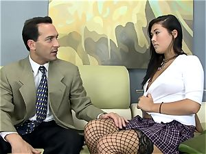 London plumbed on a bed in fishnet tights