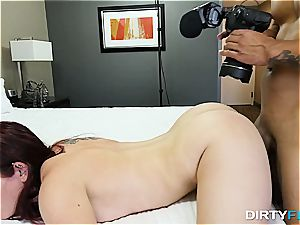 Redheaded beauty takes a penis up her pubic hair