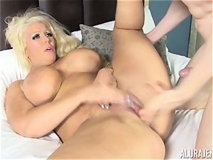 Creep wedges his pink cigar into the face of Alura Jenson while sleeping