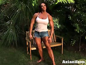 killer muscled Amber strips down and paws her immense clitoris