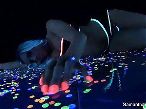 Samantha Saint has some fun underneath a black light