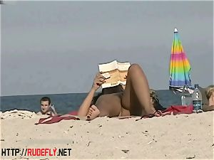 scorching honies filmed lounging on a naturist beach