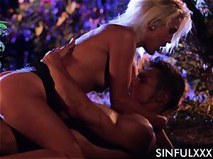 Cecilia Scott in a sensuous scene with a hunky boy